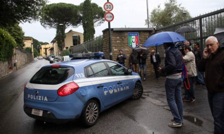 An Italian police car arrives at the site where the Italy national team is training