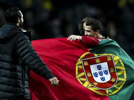 cristiano-ronaldo-wrapped-up-in-a-portugal-flag
