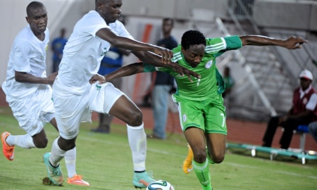 South Africa's Eric Mathoho, left, and Nigeria's Ahmed Musa