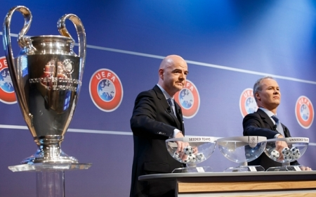 UEFA General Secretary Gianni Infantino, left, and UEFA Competitions Director Giorgio Marchetti, right, remove the balls containing the names of the soccer clubs, during the draw for the Champions League 2015/16 play-offs, at the UEFA Headquarters in Nyon, Switzerland, Friday, Aug. 7, 2015. (Salvatore Di Nolfi/Keystone via AP)