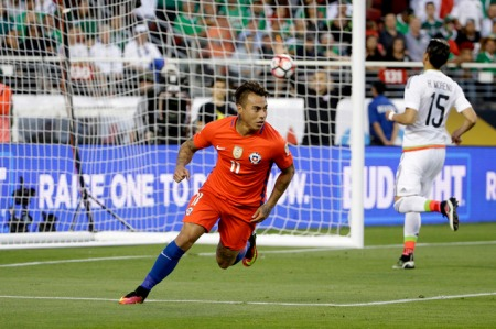 Chile's Eduardo Vargas celebrates after scoring against Mexico during a Copa America Centenario quarterfinal soccer match at Levi's Stadium in Santa Clara, Calif., Saturday, June 18, 2016. Chile won 7-0. (AP Photo/Jeff Chiu)