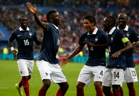 France's Paul Pogba (2nd L) celebrates with team mates after scoring against Portugal during their friendly soccer match at the Stade de France in Saint-Denis near Paris October 11, 2014. REUTERS/Charles Platiau (FRANCE - Tags: SPORT SOCCER) - RTR49T0J
